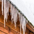 Stock Photo: House roof icicles