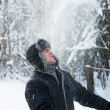 Stock Photo: Mthrows snow