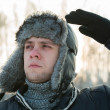 Stock Photo: Man in a fur winter hat