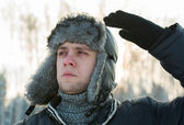 Man in a fur winter hat — Stock Photo
