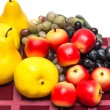 Fruit on a red tablecloth — Stock Photo