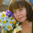 Stock Photo: Middle-aged womwith flowers