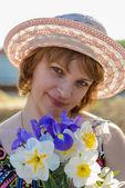Middle-aged woman with flowers — Stock Photo