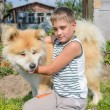 Stock Photo: Boy with dog