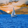 Sailboat at sunset — Stock Photo