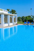 Swimming pool with sun loungers — Stock Photo