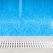 Stock Photo: Edge of swimming pool overflow