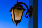 Vintage lamp on a pole in the evening after sunset — Stock Photo