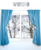 White window with blue curtains on a rainy day — Stock Photo