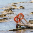 Stock Photo: Wooden bridge juts out into expanse of sea
