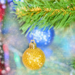 Stock Photo: Christmas decorations hanging on pine tree with glitter,