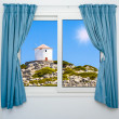 Nature landscape with a view through a window with curtains — Stock Photo #38982555