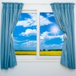 Nature landscape with a view through a window with curtains — Stock Photo #38982591