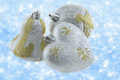 Christmas decorations on a background of brilliant snow — Stock Photo