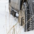 Stock Photo: Wheel in deep winter snow snowbank