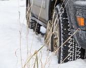 Wheel in deep winter snow snowbank — Stock Photo