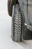 Wheel in deep winter snow snowbank — Stock Photo