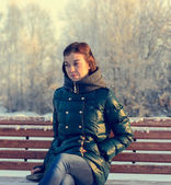 Portrait of young brunette girl in jacket — Stock Photo