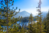 Mountain landscape in sunny winter frosty day with blue clear sky. — Stock Photo