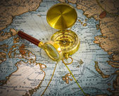 Compass and magnifying glass — Стоковое фото