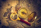 Compass and magnifying glass — Stock Photo