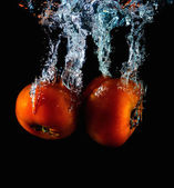 Tomato falling into water abstract — Foto de Stock