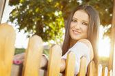 Beautiful young woman enjoying autumn nature in park — Stock Photo