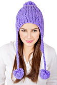 Pretty young woman wearing a purple hat isolated on white — Stock Photo