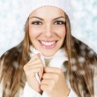 Smiling beautiful woman with white hat and scarf — Stock Photo