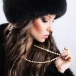 Beautiful woman in luxury fur — Stock Photo