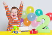 Adorable little boy celebrating second birthday — ストック写真