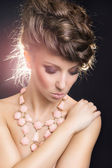 Sensual woman with modern necklace and hairdo — Stock Photo