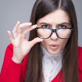 Surprised businesswoman with nerd glasses — Stock Photo