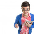 Confused fashionable young man using digital tablet — Stock Photo