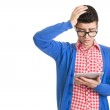 Sad young man with digital tablet — Stock Photo