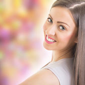 Beautiful young woman smiling — Stock Photo