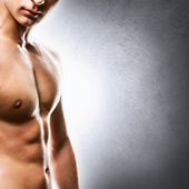 Handsome young man's torso closeup — Stock Photo