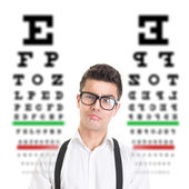 Young hipster man having trouble with eyesight — Stock Photo