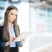 Businesswoman at work using digital tablet — Stock Photo