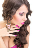 Sensual brunette in pink — Stock Photo