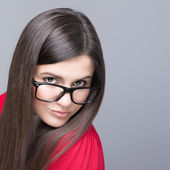 Beautiful businesswoman wearing black nerd glasses — Stock Photo