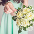 Stock Photo: Bridesmaid holding yellow bouquet