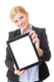 Happy young blonde businesswoman showing tablet computer screen — Stock Photo
