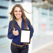 Positive young businesswoman with tablet computer — Stock Photo