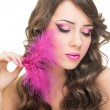 Glamorous young woman with pink feather — Stock Photo