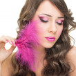 Stock Photo: Glamorous young womwith pink feather