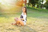 Happy young woman enjoying a beautiful day outdoors — Stock Photo