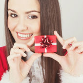 Happy young Caucasian brunette woman with little present — Stock Photo