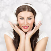 Cute young woman wearing ear muff smiling — Stock Photo