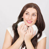 Beautiful young brunette woman with white fluffy ear muff — Stock Photo